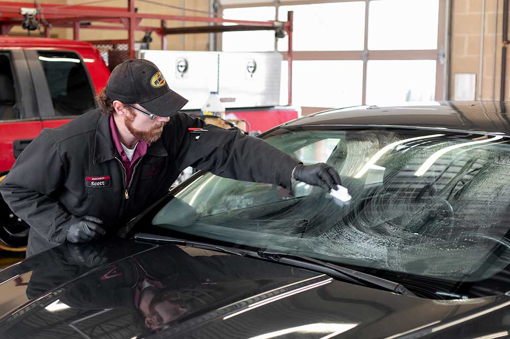 Man Applying Windshield Treatment